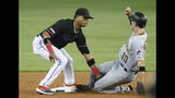 Miami Marlins second baseman Starlin Castro, left, tags out Pittsburgh Pirates' Bryan Reynolds on an attempted steal of second base during the first inning of a baseball game Saturday, June 15, 2019, in Miami. (AP Photo/Wilfredo Lee)