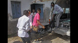 The body of one of the victims of a bomb attack is brought to the morgue at a hospital in the capital Mogadishu, Somalia, Saturday, June 15, 2019. (AP Photo/Farah Abdi Warsameh)