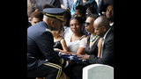The folded American Flag is presented to West Point Cadet Christopher J. Morgan's parents, April and Christopher by Superintendent Darryl Williams, during the interment ceremony at West Point, N.Y., Saturday, June 15, 2019. Over 1500 family, friends and military personnel attended, as well as former President Bill Clinton who delivered remarks at the memorial service. (Mark Vergari/The Journal News via AP)