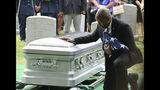 Christopher C. Morgan touches the casket of his son, West Point Cadet Christopher J. Morgan, during the interment ceremony at West Point, N.Y., Saturday, June 15, 2019. Over 1500 family, friends and military personnel attended, as well as former President Bill Clinton who delivered remarks at the memorial service. (Mark Vergari/The Journal News via AP)