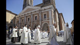 Pope Francis walks in procession in front of the Cathedral of Camerino, Italy, as he arrives to celebrate mass, Sunday, June 16, 2019. The town of Camerino was heavily damaged by the 2016 earthquake that hit the central Italian Marche region. (AP Photo/Gregorio Borgia)