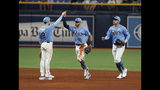 Tampa Bay Rays' Brandon Lowe, left, celebrates with teammate Tommy Pham, center, after deafening the Los Angeles Angels in a baseball game Sunday, June 16, 2019, in St. Petersburg, Fla. (AP Photo/Scott Audette)