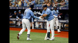 Tampa Bay Rays Brandon Lowe, left, celebrates with the Rays Ji-Man Choi after hitting a home run against the Los Angeles Angels during the first inning of a baseball game Sunday, June 16, 2019, in St. Petersburg, Fla. (AP Photo/Scott Audette)