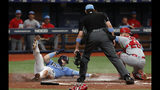 Tampa Bay Rays' Austin Meadows, left, is tagged out at home by Los Angeles Angels catcher Mike Zunino during the third inning of a baseball game Sunday, June 16, 2019, in St. Petersburg, Fla. (AP Photo/Scott Audette)