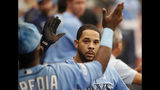 Tampa Bay Rays Tommy Pham celebrates in the dug out after hitting a home run against the Los Angeles Angels during the fifth inning of a baseball game Sunday, June 16, 2019, in St. Petersburg, Fla. (AP Photo/Scott Audette)