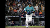 Seattle Mariners' Edwin Encarnacion tosses aside his bat after hitting a three-run home run against the Houston Astros durng the sixth inning of a baseball game Wednesday, June 5, 2019, in Seattle. (AP Photo/Elaine Thompson)