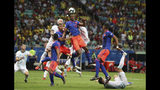 Colombia's Yerry Mina, top, heads the ball during a Copa America Group B soccer match at the Arena Fonte Nova in Salvador, Brazil, Saturday, June 15, 2019. (AP Photo/Natacha Pisarenko)