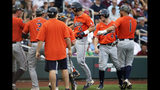 Auburn's Edouard Julien (10) celebrates his two-run home run against Mississippi State in the second inning of an NCAA College World Series baseball game in Omaha, Neb., Sunday, June 16, 2019. Rankin Woley also scored on the play. (AP Photo/Nati Harnik)