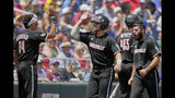 Louisville's Justin Lavey, center, celebrates with teammates after scoring against Vanderbilt on a single by Henry Davis in the fifth inning of an NCAA College World Series baseball game in Omaha, Neb., Sunday, June 16, 2019. (AP Photo/Nati Harnik)