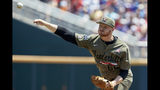 Vanderbilt starting pitcher Drake Fellow throws against Louisville in the first inning of an NCAA College World Series baseball game in Omaha, Neb., Sunday, June 16, 2019. (AP Photo/Nati Harnik)