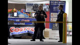 The Corona police department investigate a shooting inside a Costco in Corona, Calif., Friday, June 14, 2019. A gunman opened fire inside the store during an argument, killing a man, wounding two other people and sparking a stampede of terrified shoppers before he was taken into custody, police said. The man involved in the argument was killed and two other people were wounded, Corona police Lt. Jeff Edwards said. (Will Lester/Inland Valley Daily Bulletin/SCNG via AP)
