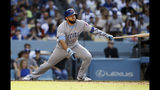 Chicago Cubs' David Bote has an RBI sacrifice fly to right field to score Kris Bryant during the fifth inning of a baseball game against the Los Angeles Dodgers in Los Angeles, Sunday, June 16, 2019. (AP Photo/Alex Gallardo)