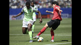 Nigeria's Chidinma Okeke, left, challenges South Korea's Lee Geum-min during the Women's World Cup Group A soccer match between Nigeria and South Korea in Grenoble, France, Wednesday June 12, 2019.(AP Photo/Laurent Cipriani)