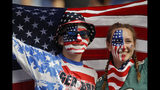 Brothers Austin, left, and Jordyn Chambers, from Philadelphia, hold up an US flag prior the Women's World Cup Group F soccer match between United States and Chile at Parc des Princes in Paris, France, Sunday, June 16, 2019. (AP Photo/Alessandra Tarantino)