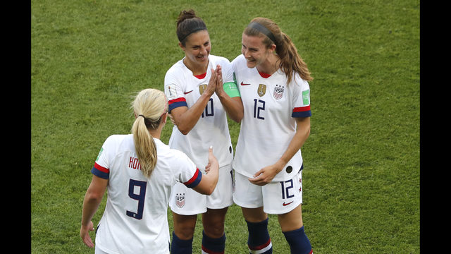 4b5aaf951e6 United States' Carli Lloyd , center, celebrates with Lindsey Horan and  Tierna Davidson, right, after scoring the opening goal during the Women's World  Cup ...