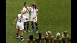 United States' Carli Lloyd, top center, celebrates with Lindsey Horan and Tierna Davidson, right, after scoring the opening goal during the Women's World Cup Group F soccer match between the United States and Chile at the Parc des Princes in Paris, Sunday, June 16, 2019. (AP Photo/Thibault Camus)