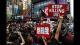 Protesters march on the streets against an extradition bill in Hong Kong on Sunday, June 16, 2019. Hong Kong residents were gathering Sunday for another massive protest over an unpopular extradition bill that has highlighted the territory's apprehension about relations with mainland China, a week after the crisis brought as many as 1 million into the streets. (AP Photo/Vincent Yu)