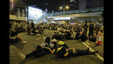 Protesters rest on the streets as they continue a protest overnight near the Legislative Council into the early hours of Monday, June 17, 2019 in Hong Kong. Hong Kong citizens marched for hours Sunday in a massive protest that drew a late-in-the-day apology from the city's top leader for her handling of legislation that has stoked fears of expanding control from Beijing in this former British colony. (AP Photo/Vincent Yu)