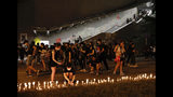 Protesters light candles as they continue a protest overnight near the Legislative Council into the early hours of Monday, June 17, 2019, in Hong Kong. Hong Kong citizens marched for hours Sunday in a massive protest that drew a late-in-the-day apology from the city's top leader for her handling of legislation that has stoked fears of expanding control from Beijing in this former British colony. (AP Photo/Vincent Yu)