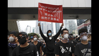 Protesters demand embattled Hong Kong leader resign