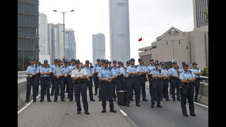 The Latest: HK protesters mass outside city leader
