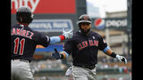 Cleveland Indians' Carlos Santana celebrates scoring with Jose Ramirez (11) against the Detroit Tigers in the first inning of a baseball game in Detroit, Sunday, June 16, 2019. (AP Photo/Paul Sancya)