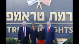 Israeli Prime Minister Benjamin Netanyahu, right, his wife Sara , United States Ambassador to Israel David Friedman, left, his wife Tammy pose during the inauguration of a new settlement named after President Donald Trump in the Golan Heights, Sunday, June 16, 2019. The Trump name graces apartment towers, hotels and golf courses. Now it is the namesake of a tiny Jewish settlement in the Israeli-controlled Golan Heights. (AP Photo/Ariel Schalit)
