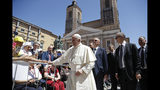 Pope Francis leaves after celebrating mass in Camerino, Italy, Sunday, June 16, 2019. The town of Camerino was heavily damaged by the 2016 earthquake that hit the central Italian Marche region. (AP Photo/Gregorio Borgia)
