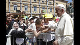 Pope Francis greets faithful as he leaves after celebrating mass in Camerino, Italy, Sunday, June 16, 2019. The town of Camerino was heavily damaged by the 2016 earthquake that hit the central Italian Marche region. (AP Photo/Gregorio Borgia)