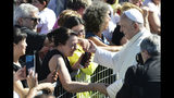 Pope Francis greets residents of temporary houses in the village of Cortine, that was severely damaged by the 2016 earthquake, near Camerino, Italy, Sunday, June 16, 2019. Pope Francis after visiting residents will be celebrating mass in front of the cathedral of Camerino that was also damaged by the 2016 earthquake that hit the central Italian Marche region. (AP Photo/Sandro Perozzi)