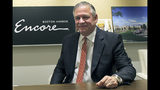 In this June 7, 2019 photo, Encore Boston Harbor casino president Robert DeSalvo sits in the company's administrative office in Medford, Mass. The casino is scheduled to open in nearby Everett on Sunday, June 23. (AP Photo/Philip Marcelo)