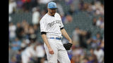 Colorado Rockies relief pitcher Wade Davis reacts after giving up a triple to San Diego Padres' Greg Garcia to allow in two runs in the ninth inning of a baseball game Sunday, June 16, 2019, in Denver. (AP Photo/David Zalubowski)