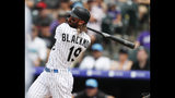Colorado Rockies center fielder Charlie Blackmon follows the flight of his RBI-single off San Diego Padres relief pitcher Phil Maton in the sixth inning of a baseball game Sunday, June 16, 2019, in Denver. (AP Photo/David Zalubowski)