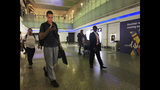 Mariners from the MT Front Altair arrive at Dubai International Airport in Dubai, United Arab Emirates, on Saturday, June 15, 2019, after spending two days in Iran. Associated Press journalists saw the crew members of the MT Front Altair on Saturday night after their Iran Air flight from Bandar Abbas, Iran, landed in Dubai in the United Arab Emirates. The Norwegian-owned oil tanker was attacked Thursday, June 13, in the Gulf of Oman. The U.S. has accused Iran of attacking the Front Altair and another oil tanker with limpet mines. Iran has denied the allegations. (AP Photo/Jon Gambrell)