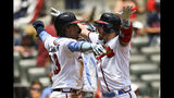 Atlanta Braves' Josh Donaldson, right, celebrates his two-run home run with Ronald Acuna Jr., left, at home plate during the third inning of a baseball game against the Philadelphia Phillies, Sunday, June 16, 2019, in Atlanta. (AP Photo/John Amis)