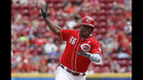 Cincinnati Reds' Yasiel Puig runs to third on a single by Josh VanMeter off Texas Rangers relief pitcher Ariel Jurado in the second inning of a baseball game, Sunday, June 16, 2019, in Cincinnati. (AP Photo/John Minchillo)