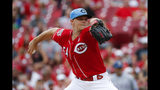 Cincinnati Reds starting pitcher Sonny Gray throws in the first inning of a baseball game against the Texas Rangers, Sunday, June 16, 2019, in Cincinnati. (AP Photo/John Minchillo)