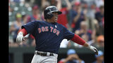 Boston Red Sox's Rafael Devers smiles as he scores on a double by Xander Bogaerts against the Baltimore Orioles in the fourth inning of a baseball game Sunday, June 16, 2019, in Baltimore. (AP Photo/Gail Burton)