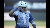 Kansas City Royals' Martin Maldonado walks on the field during a baseball game against the Minnesota Twins, Sunday, June 16, 2019, in Minneapolis. Maldonado celebrated Father's Day by wearing a blue necktie on his chest protector and had three hits to lift the Kansas City Royals over the Minnesota Twins 8-6 on Sunday. (AP Photo/Stacy Bengs)