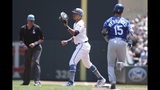 Minnesota Twins' Ehire Adrianza holds onto the ball at first to get out Kansas City Royals' Whit Merrifield during the first inning of a baseball game Sunday, June 16, 2019, in Minneapolis. Minnesota Twins' shortstop Jorge Polanco threw the ball to Adrianza for the out. (AP Photo/Stacy Bengs)