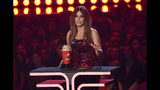 """Sandra Bullock accepts the award for most frightened performance for """"Bird Box"""" at the MTV Movie and TV Awards on Saturday, June 15, 2019, at the Barker Hangar in Santa Monica, Calif. (Photo by Chris Pizzello/Invision/AP)"""