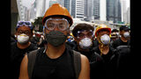 Protesters wearing protection gears march toward the Legislative Council as they continue to protest against the extradition bill in Hong Kong, Monday, June 17, 2019. Hong Kong police and protesters faced off Monday as authorities began trying to clear the streets of a few hundred who remained near the city government headquarters after massive demonstrations that stretched deep into the night before.(AP Photo/Vincent Yu)
