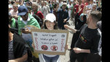 """Algerian protesters gather during an anti-government demonstration in the centre of the capital Algiers, Algeria, Friday, June 7, 2019. Banner in Arabic reads """"No to PM Bensaleh's second mandate"""". (AP Photo/Fateh Guidoum)"""