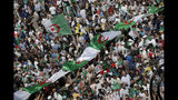 Algerian protesters gather during an anti-government demonstration in the centre of the capital Algiers, Algeria, Friday, June 14, 2019. Algeria is in the midst of an unprecedented anti-corruption crusade, sparked by a people's revolt in February and prompting many lawmakers to be questioned over allegations, and former Algerian prime minister Abdelmalek Sellal jailed Thursday in an anti-corruption sweep.(AP Photo/Fateh Guidoum)