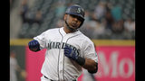 Seattle Mariners' Edwin Encarnacion rounds the bases after hitting a solo home run against the Houston Astros during the third inning of a baseball game, Monday, June 3, 2019, in Seattle. (AP Photo/Ted S. Warren)