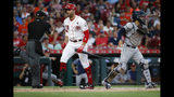 Cincinnati Reds' Joey Votto (19) reacts after striking out in the first inning of a baseball game against the Houston Astros, Monday, June 17, 2019, in Cincinnati. (AP Photo/John Minchillo)
