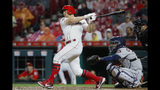 Cincinnati Reds' Nick Senzel hits a two-run single off Houston Astros starting pitcher Wade Miley in the fifth inning of a baseball game, Monday, June 17, 2019, in Cincinnati. (AP Photo/John Minchillo)