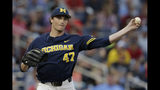 Michigan starting pitcher Tommy Henry (47) throws to first in a pickoff-attempt in the fifth inning of an NCAA College World Series baseball game against Florida State in Omaha, Neb., Monday, June 17, 2019. (AP Photo/Nati Harnik)
