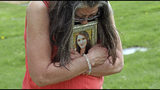 Melany Zoumadakis clutches a photo of her daughter, Tanna Jo Fillmore, on Friday, April 26, 2019, in Salt Lake City. Fillmore killed herself in the Duchesne County Jail in 2016, after repeatedly calling her mother, saying she was being denied her prescription medicines that had stabilized her. Her mother has filed suit. (AP Photo/Rick Bowmer)