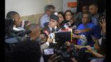 Lawyer José Martínez Hoepelman, who represents former Boston Red Sox slugger David Ortiz, speaks to the press outside court in Santo Domingo, Dominican Republic, Monday, June 17, 2019. Ortiz was shot in the back at a bar in the Dominican Republic on Sunday, June 9. (AP Photo/Roberto Guzman)